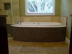Yes Final Touch Flooring Group in historic Acworth GA  renovated this tub as well.  So pretty....