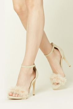 A pair of faux suede heels featuring a feather accented strap across an open-toe and an ankle strap with a high-polish buckle closure.