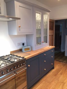 Marston and Langinger paints in shaker style bespoke kitchen with oak worksurfaces.