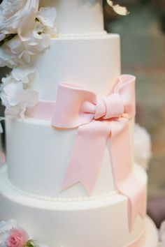 And there is a BOW!!!   Five Tier Round Fondant Wedding Cake With Pink Bow at Shutters on the Beacj