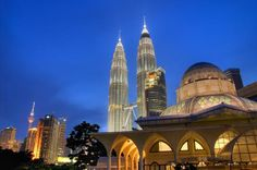 Full-Day Kuala Lumpur City Tour including Petronas Towers and Batu Caves Explore and admire the beauty of several iconic buildings that represent Kuala Lumpur on this fantastic full-day tour. Ascend the world renowned Petronas Twin Towers and walk on the tallest skybridge in the world, climb 272 stairs at Batu Caves to seek 'enlightenment', buy souvenirs from Central Market, enjoy a nice photo session at National Monument, and visit the King Palace and Independent Square to fi...