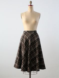 late 1950s - early 1960s A vintage wool plaid skirt. The a-line skirt features a…