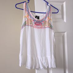Boho Embroidered Tank Semi-sheer white tank with bright stitching across the neckline, such a great piece for this spring/summer! Flares out at bottom with a cute ruffle. Only worn once, in excellent condition. Tops Tank Tops