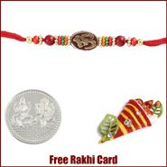 Om Beads Rakhi to Canada  with Free Silver Coin