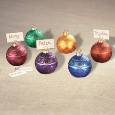 place card holders fashioned to look like festive christmas ball ornaments are a sensational finishing touch to holiday season wedding table decor