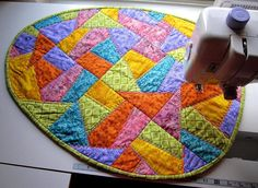 Love this quilted easter egg table runner! Click to get the pattern.