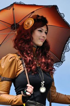 Steampunk in Shades of Orange - For costume tutorials, clothing guide, fashion inspiration photo gallery, calendar of Steampunk events, & more, visit SteampunkFashionGuide.com