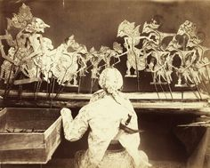A dalang performing wayang kulit in Java, c. 1890 Wayang is a Javanese word for…