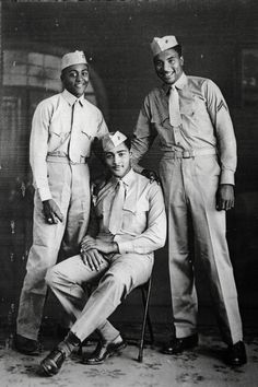 In this undated handout image provided by Carrel Reavis, Reavis is seen, right, posing with two other Marines in uniform. Nearly 70 years after the Marine Corps, the last military branch to racially i