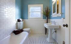 small bathroom tile ideas blue and white with cool bathroom flooring ideas tiles and white modern vanity sinks with stainless steel faucet Small Bathroom Tiles, Wainscoting Bathroom, Bathroom Rules, Bathroom Windows, White Bathroom, Bathroom Flooring, Bathroom Wall, Modern Bathroom, Bathroom Ideas