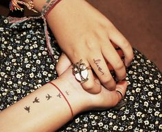 """more birds. and i like the font of the word """"live"""" on her finger. maybe i could do """"love"""" on my ring finger?"""