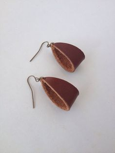 Great for any minimalist jewelry wearer. These leather earrings are a soft and elegant accessory to your ensemble! Materials  Quality Leather  Antiqued