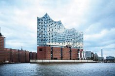 a concert hall in the HafenCity quarter of Hamburg, Germany by magone. Elbphilharmonie, a concert hall in the Hafen City quarter of Hamburg, Germany Graphic Design Layouts, Travel News, Concert Hall, Travel Information, Willis Tower, Karl Lagerfeld, Textured Background, Marina Bay Sands, Places Ive Been