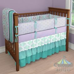 Crib bedding in Solid Teal, Aqua Haute Circles, Solid Lilac, Lilac and Silver Gray Damask, Mint Large Quatrefoil, Solid Emerald Turquoise. Created using the Nursery Designer® by Carousel Designs where you mix and match from hundreds of fabrics to create your own unique baby bedding. #carouseldesigns
