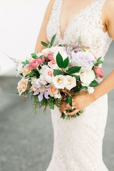 This beautiful summer wedding bouquet were featured in a real wedding from California on The Knot. In love with pink and purple wedding flowers? Check these out and more from the romantic wedding. Personalize your wedding and put a spin on tradition with The Knot's customizable wedding websites, wedding invitations, registry (and more!). Not sure where to start? Get ideas and advice from our editors on everything from wedding colors and venue types to all things guest.