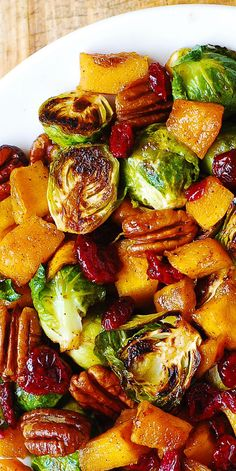 Thanksgiving Salad: Butternut Squash Brussels sprouts Cranberries Pecans The post Thanksgiving Salad: Butternut Squash Brussels sprouts Cranberries Pecans appeared first on Tasty Recipes. Side Dish Recipes, Veggie Recipes, Vegetarian Recipes, Dinner Recipes, Cooking Recipes, Healthy Recipes, Delicious Recipes, Vegan Brussel Sprout Recipes, Salad Recipes
