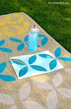 Outdoor rugs can be expensive, but these easy directions will help you a stenciled outdoor rug using a few simple tools. Customize an old rug using your favorite paint colors with our DIY stenciled outdoor rug craft!
