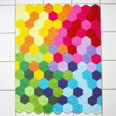 "The Rainbow Hexie Blanket - Information on where she got the hexagon is provided... BUT you can use any hexagon pattern to make this. (Just search Ravelry or Pinterest for ""Free Crochet Hexagon Pattern"")"