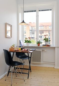 small kitchen dining. Small cosy table at the end of the kitchen for breakfast, coffee, writing. Breaks up a long thin kitchen. Makes the most of a nice window.