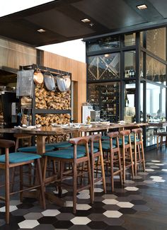 Commercial Dining - upholstered walnut chairs, live edge table, tile, wood floors.