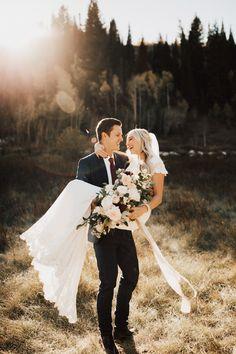 Groom carrying bride in wedding photos