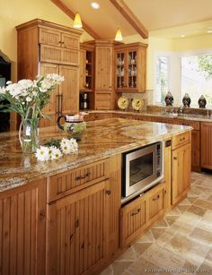 A Large Country Kitchen with Knotty Alder Cabinets...cabinets have the look of ours - looks nice with yellow paint