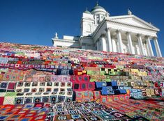 Crocheting: The largest blanket in the world-- The goal was to crochet 1000 blankets to cover the stairs of the Helsinki Cathedral and then donate those to families in need.