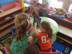 Stoy students gather around one of their iPads during