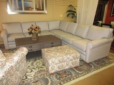 """95.00  Item #: 41226 Two piece sectional from Matter Brothers in a gray color upholstery with darker gray trim. The simple design and clean lines make this piece an excellent match for a contemporary or transitional style home. Measurements are 113"""" x 113"""" x 31""""."""