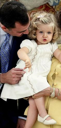 15 July 2007 - Princess Leonor (then Infanta Leonor) at the baptism of her sister, Infanta Sofía, w/ her dad, then Prince Felipe, held by her Grandmother Queen Sofía of Spain.
