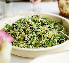 Cook baby spinach with the rice to bring out the colour in this vegetarian side dish - perfect as part of a Greek Easter lunch