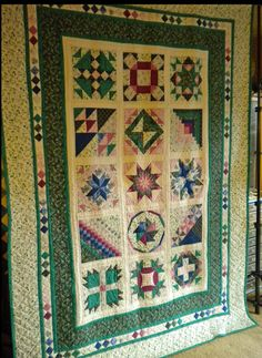 This was my big UFO project for 2013--a sampler quilt I made for my daughter's high school graduation in 1992. I handquilted everything but the final border work. Last year I decided I either finish it by machine or it would never get finished. Now it's done!