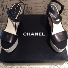 Chanel* Black* White* Platform CHANEL* Black and White* Platform* Sandal* Silver CC Closure* Platform* Authentic* Worn Twice* Scuffed on Left Inside of Platform {shown in picture}* Knick on Tip of Right Shoe {shown in picture}* Original Box* Original Dust Bags Included* CHANEL Shoes Platforms