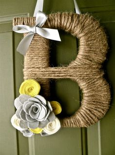 Twine Monogram Wreath with Customized Handcrafted Flowers. $16.99, via Etsy.