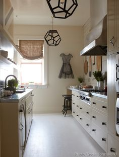 Burlap drape.  Black and white kitchen.  Neutrals.