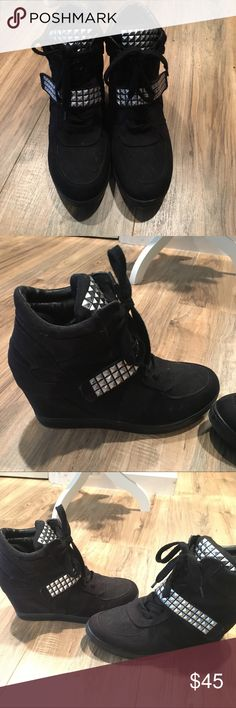 Black wedge sneakers Black wedge sneakers. Only used twice. Great condition. Gently used! Has metallic studs on tongue of shoes and across. Make an offer! Shoes Sneakers