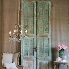 Louvers simply stacked against a wall. Simple, easy re-purposed decor idea.