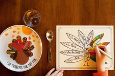 FREE Printable Placemat For Giving Thanks...kids can write what they are thankful for on the feathers...