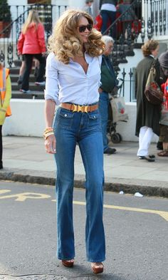 The ultimate 70s look has to be high waisted bootleg jeans with a chunky gold belt buckle.