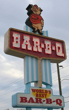 Maurice's BBQ: a restaurant with a dubious legacy, but undeniably delicious food. This sign loomed large throughout my childhood. Carolina Beach, South Carolina, Carolina Barbeque Sauce, Gas Grill Reviews, Barbecue, Bbq Signs, Bar B Q, Best Bbq, Vintage Travel Posters