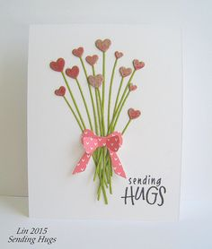 Simple and so sweet - this handmade valentine's card is a bouquet of hearts all tied up with a bow.  Use a die kit, or cut your own stems and hearts.  Use any ribbon or baker's twine for a bow.  Single layer card.