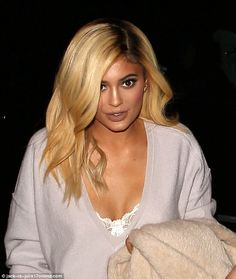 Blonde ambition: Kylie picked one of her wigs for the occasion, showing off a brassy blonde 'do