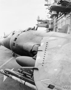 Close up of a No 1 Squadron RAF operated British Aerospace Harrier with a modified addition of an AIM 9 Sidewinder air-to-air missile mounted on the port wing, on board HMS HERMES Military Weapons, Military Aircraft, Royal Navy Aircraft Carriers, British Aerospace, Close Air Support, Falklands War, Experimental Aircraft, Commercial Aircraft, Flight Deck