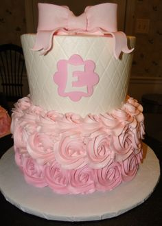 #rosettes #quilted #pink baby girl first birthday tiered cake ombre buttercream fondant bow monogram letter