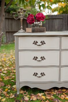 dark stain top and outline, accent drawer pulls, taupe/off white/gray main color, accent color stencil