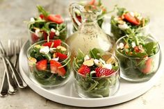 Strawberry Salad with Poppyseed Dressing. When it's hot outside, there's nothing better than a crisp, cool salad. One of my favorites is an arugula salad with strawberries, goat cheese and almonds topped with a homemade poppyseed dressing. Snacks Für Party, Appetizers For Party, Appetizer Recipes, Appetizer Salads, Lunch Party Ideas, Tea Party Recipes, Tea Party Snacks, Individual Appetizers, Shower Appetizers