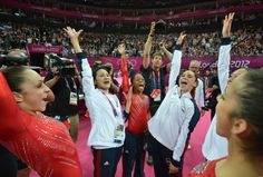 Gabrielle Douglas, (center) flanked by her U.S. gymnastics teammates, celebrates winning gold in the women's team of the artistic gymnastics event of the London Olympic Games on July 31, 2012 at the 02 North Greenwich Arena in London. Photo (c) Gregory Bull/AP via Time Magazine