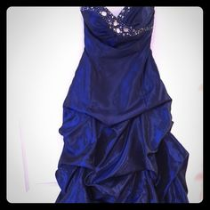 Full-length, strapless navy rhinestone ballgown This strapless navy ruffled gown will leave your date in awe at any event. The full body and collected waist is flattering on any lady with all types of hips, and the strapless, rhinestone top is elegant when combined with the lace-up back. Sexy but elegant! City Studio Dresses Prom