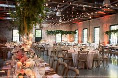 Shabby chic garden style wedding at the rustic Mt. Washington Mill Dye House with hanging greenery, cafe lights, farm tables, and uplighting.