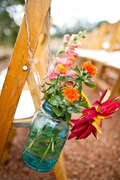 Ball Mason Jars with flowers for aisle